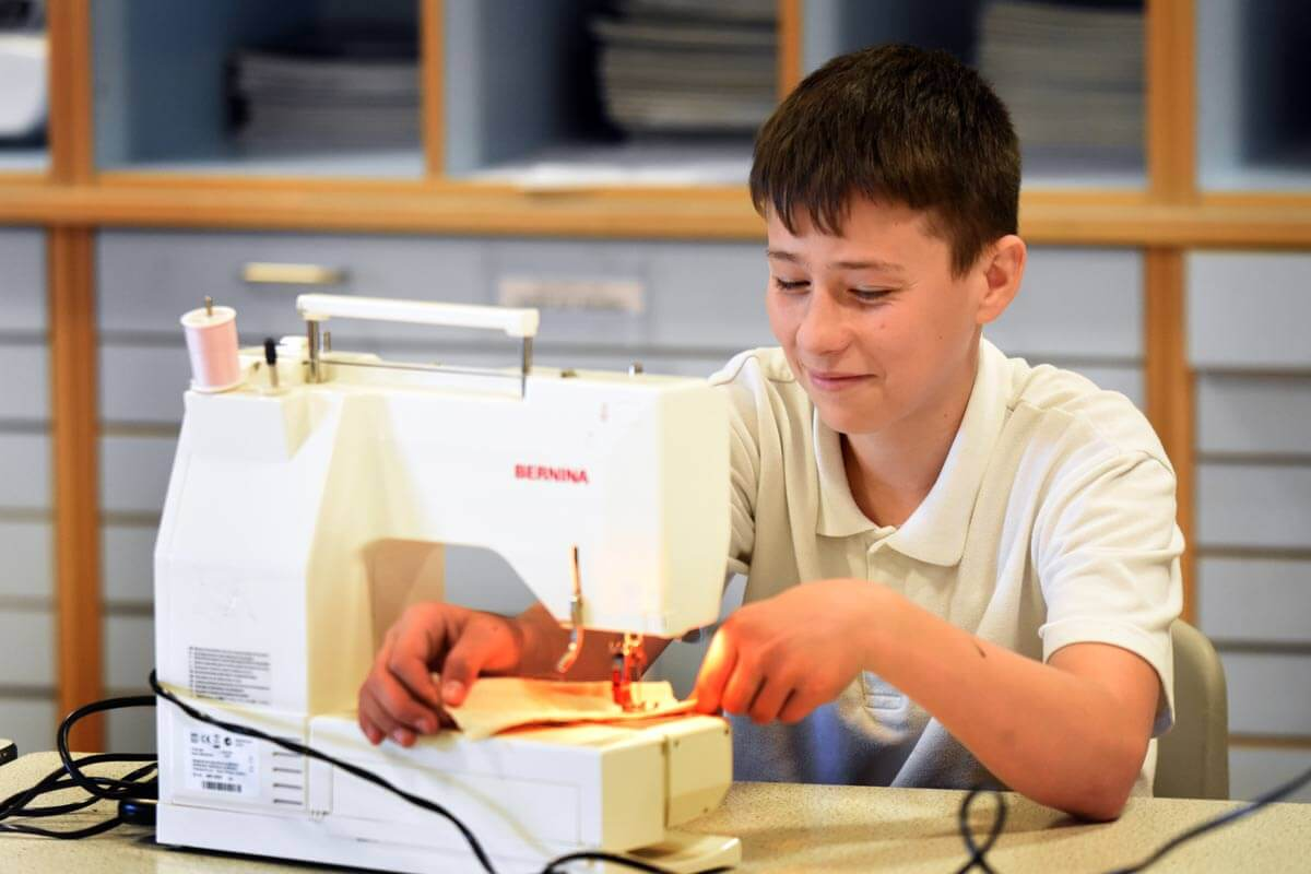 A pupil at a sewing machine